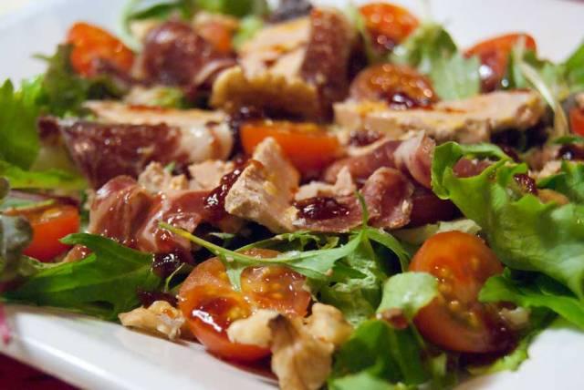 Gourmet summer salad with foie gras and Iberian ham